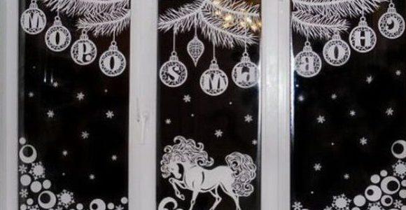 okna-ukrashennye-novogodnimi-vytynankami-foto-krasivyh-okon-v-novyj-god